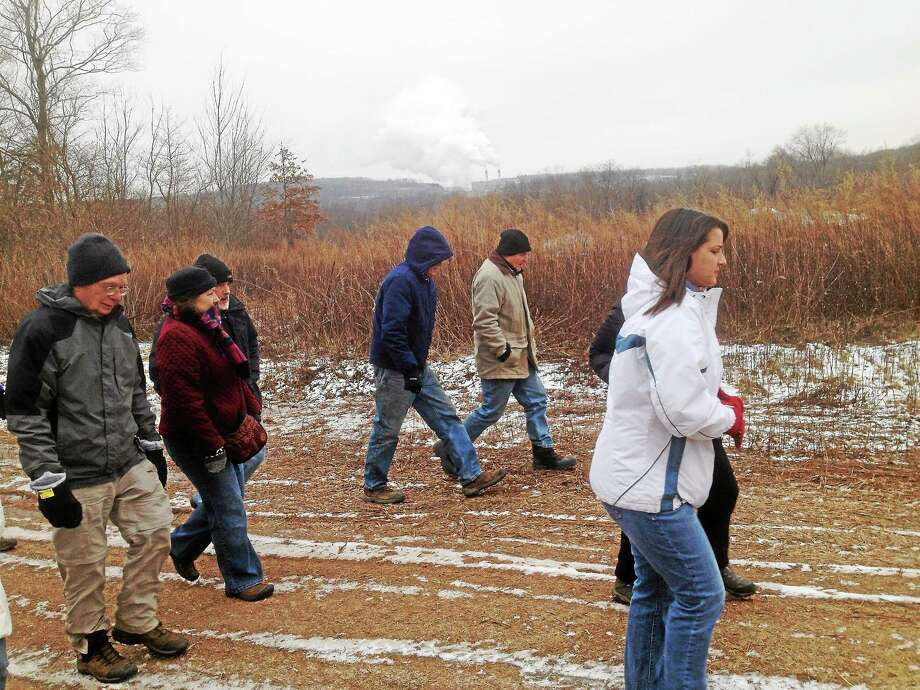 A hike by about 20 stakeholders of the Air Line Trail expansion included two state legislators in Portland this week. Photo: Jeff Mill — The Middletown Press