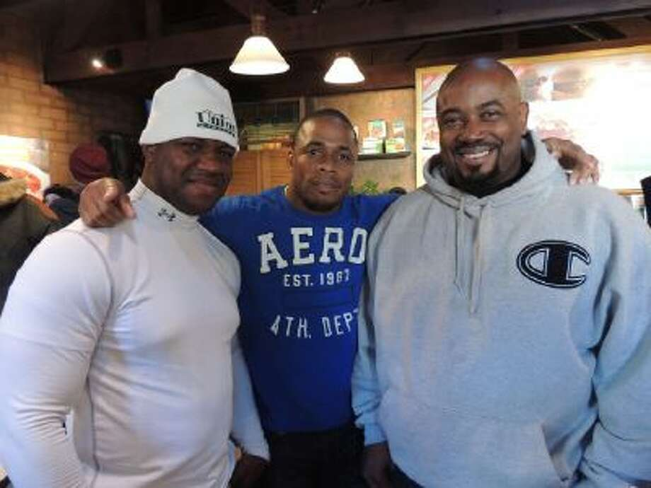 From left, Jamaican bobsled team members Wayne Blackwood, Marvin Dixon and coach Wayne Thomas pose at the MorningStar Veggie Burger Bar in Park City, Utah, Jan. 20.