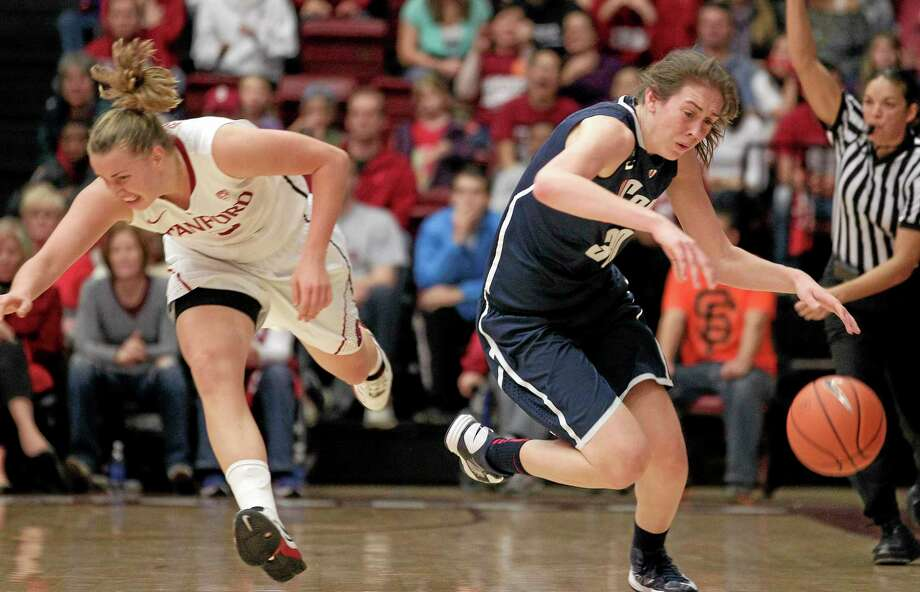 UConn's Breanna Stewart. right, steals the ball from Stanford's Mikaela Ruef during a game last season. Photo: Tony Avelar — The Associated Press File Photo  / FR155217 AP