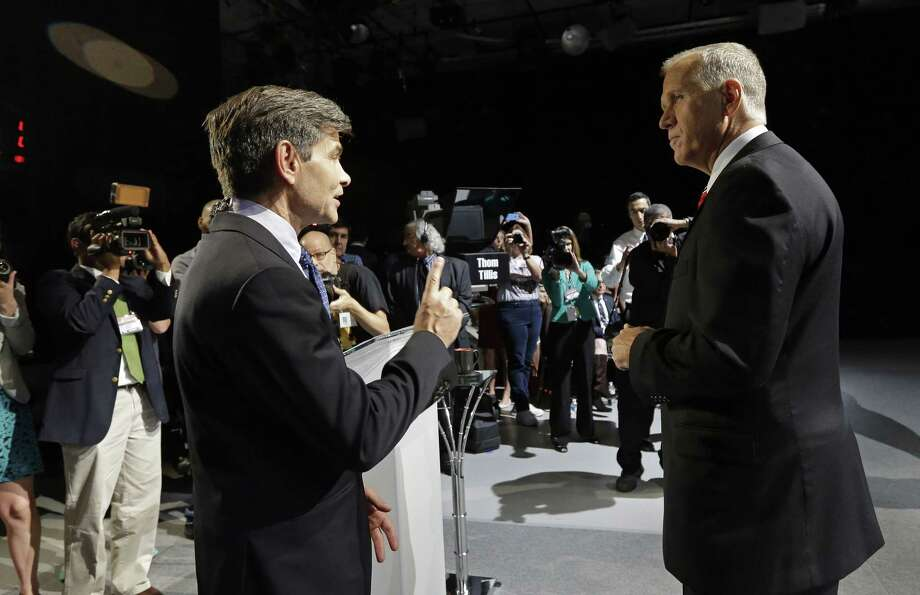 """FILE - In this Oct. 7, 2014 file photo, moderator George Stephanopoulos, left, and North Carolina Republican Senate candidate Thom Tillis speak prior to a live televised debate between Tillis and Sen. Kay Hagan, D-N.C. at UNC-TV studios in Research Triangle Park, N.C. Stephanopoulos will not moderate a Republican presidential debate next winter, part of the fallout from reports that the network's top political anchor contributed $75,000 over a three-year period to the Clinton Foundation. The co-host of """"Good Morning America"""" and host of the Sunday morning public affairs program """"This Week"""" earlier had apologized for not disclosing his contributions to his employer and viewers. Stephanopoulos voluntarily stepped away from the Feb. 6 debate, said ABC News spokeswoman Heather Riley on Thursday, May 14. Photo: (AP Photo/Gerry Broome, File) / Pool AP"""