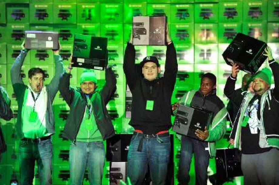 The first U.S. fans get their hands on Xbox One at the Best Buy Theater in Times Square on Friday, Nov. 22, 2013.