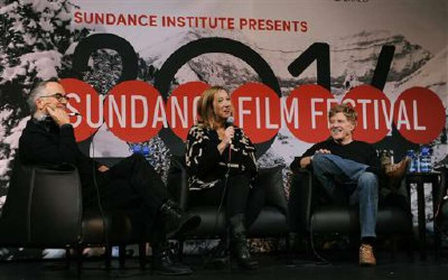 Sundance Film Festival Director John Cooper, left, Sundance Institute Executive Director Keri Putnam, center, and Robert Redford, founder and president of the Sundance Institute, share a laugh during the opening news conference of the 2014 Sundance Film Festival on Thursday, Jan. 16, 2014, in Park City, Utah. Photo: Chris Pizzello /Invision/AP / Invision