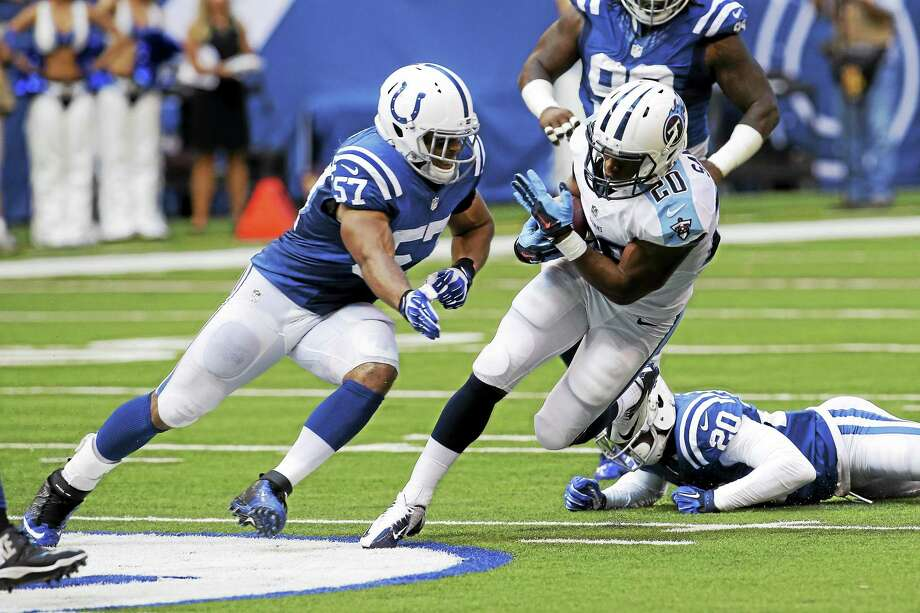 Tennessee Titans running back Bishop Sankey avoids the tackle of Colts outside linebacker Josh McNary during the second half of a Sept. 28 game in Indianapolis. Photo: AJ Mast — The Associated Press File Photo  / FR123854 AP