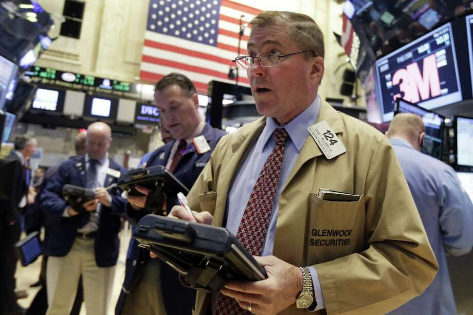 Trader David Williams, right, works on the floor of the New York Stock Exchange Friday. Photo: Richard Drew — The Associated Press  / AP