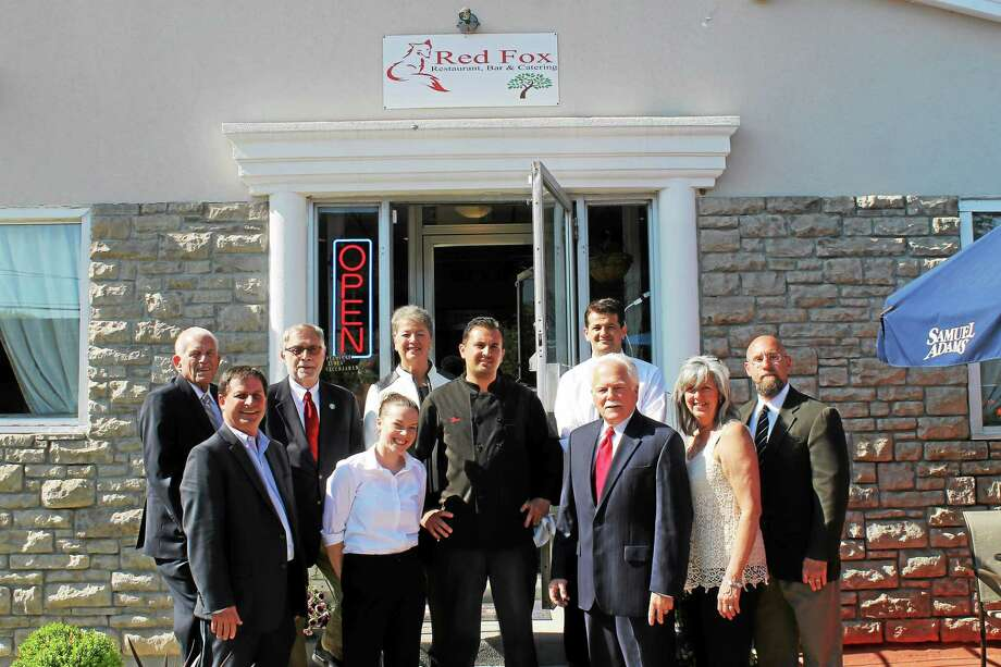 Fico Cecunjanin, center, and members of his team celebrate the grand opening of Red Fox Restaurant & Bar on Smith Street in Middletown May 14 with Chamber President Larry McHugh, Deputy Mayor Bob Santangelo, Central Business Bureau Chairman Phil Ouellette and other business leaders and supporters. Photo: Courtesy Middlesex County Chamber Of Commerce