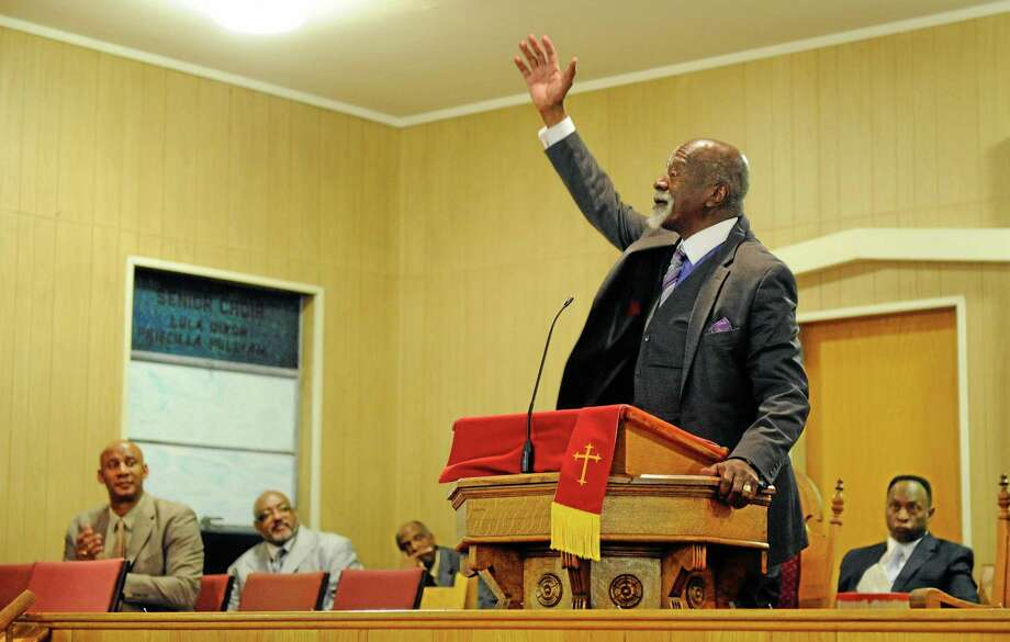Dr. Anthony Brooks ends his keynote speech celebrating the life and work of Dr. Martin Luther King, Jr. during the Henderson County Black History Committee's program at Greater Norris Chapel Baptist Church in Henderson, Ky Sunday Jan. 19, 2014. (AP Photo/The Gleaner, Darrin Phegley) Photo: AP / The Gleaner