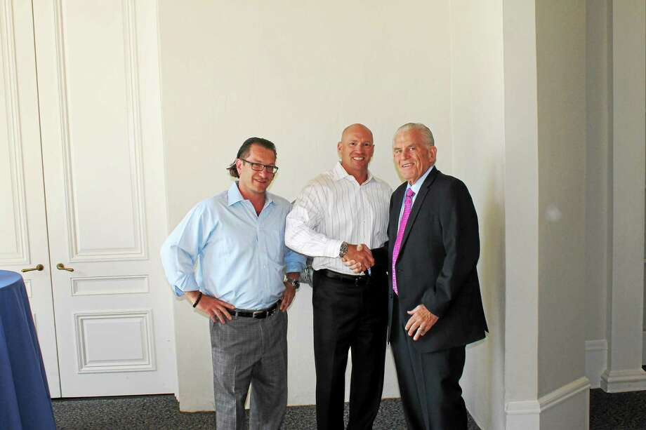 Chamber President Larry McHugh, right, congratulates Connecticut Underwriters President Bill Kiley, center, and Executive Vice President Bryan Kiley, left, on the company's 50th anniversary. Photo: Courtesy Photo