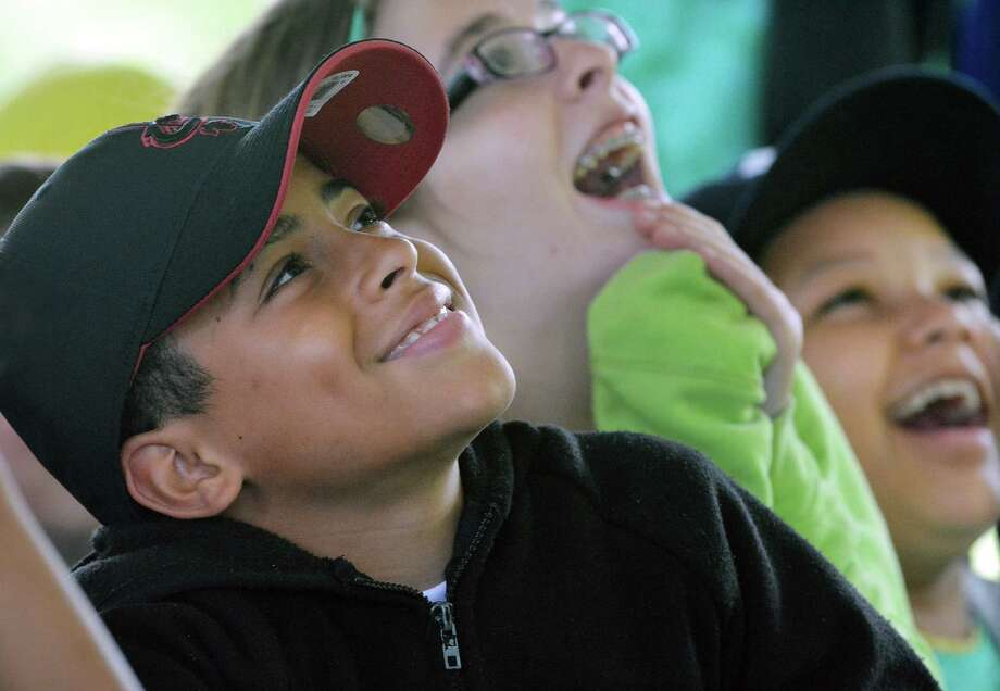 Mentees enjoy a magic show at the Middlesex County Chamber of Commerce Mentor Program end of the year picnic at Battell Hall Picnic Grove at Connecticut Valley Hospital Friday afternoon. Photo: Catherine Avalone - The Middletown Press