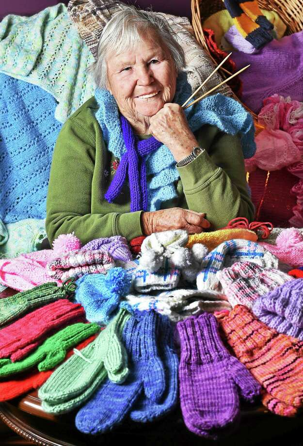 Dedicated knitter Lorraine Cienava, 81, of Middletown is surrounded by a kaleidoscope of her hand-crafted creations. Photo: Submitted Photo  / New Haven RegisterThe Middletown Press