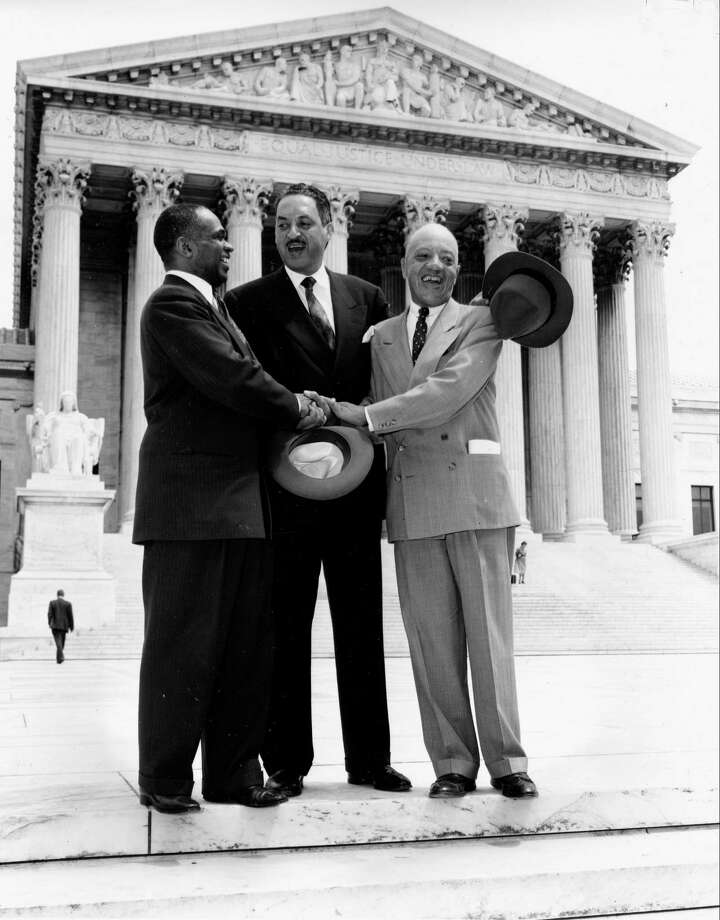 This May 17, 1954 file photo shows, from left, George E.C. Hayes, Thurgood Marshall and James M. Nabrit joining hands as they pose outside the Supreme Court in Washington. The three lawyers led the fight for abolition of segregation in public schools before the Supreme Court, which ruled that segregation is unconstitutional. (AP Photo, File) Photo: AP / AP