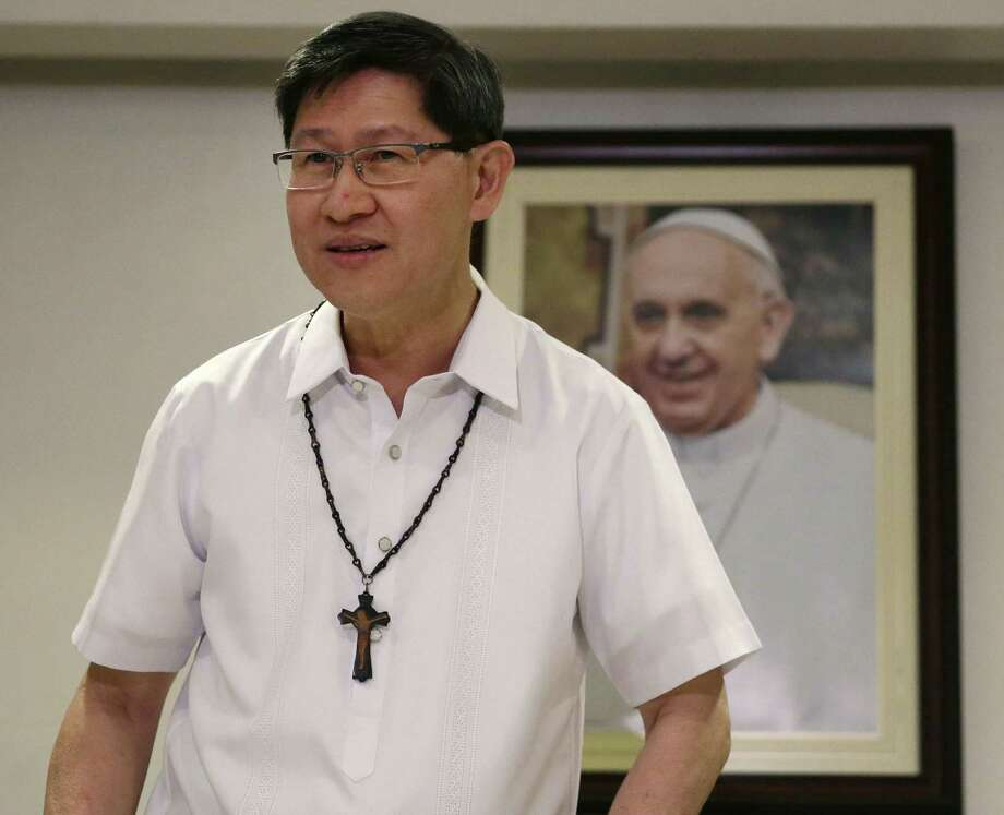 FILE - In this July 29, 2014 file photo, Manila Archbishop Cardinal Luis Antonio Tagle prepares for a simultaneous announcement with the Vatican on the five-day Apostolic visit of Pope Francis to the Philippines in mid-January in 2015, in Manila, Philippines. Pope Francis will be welcomed in the Catholic heartland on Thursday, Jan. 15, 2015, by the Filipino cardinal who might one day succeed him: a boyish-looking priest who rode the bus as a bishop and has impressed many with a humble life, intellect and compassion for the poor. (AP Photo/Bullit Marquez, File) Photo: AP / AP