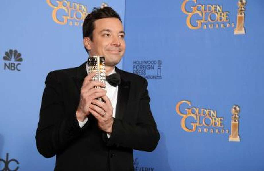 Jimmy Fallon poses in the press room at the 71st annual Golden Globe Awards at the Beverly Hilton Hotel on Sunday, Jan. 12, 2014, in Beverly Hills, Calif.