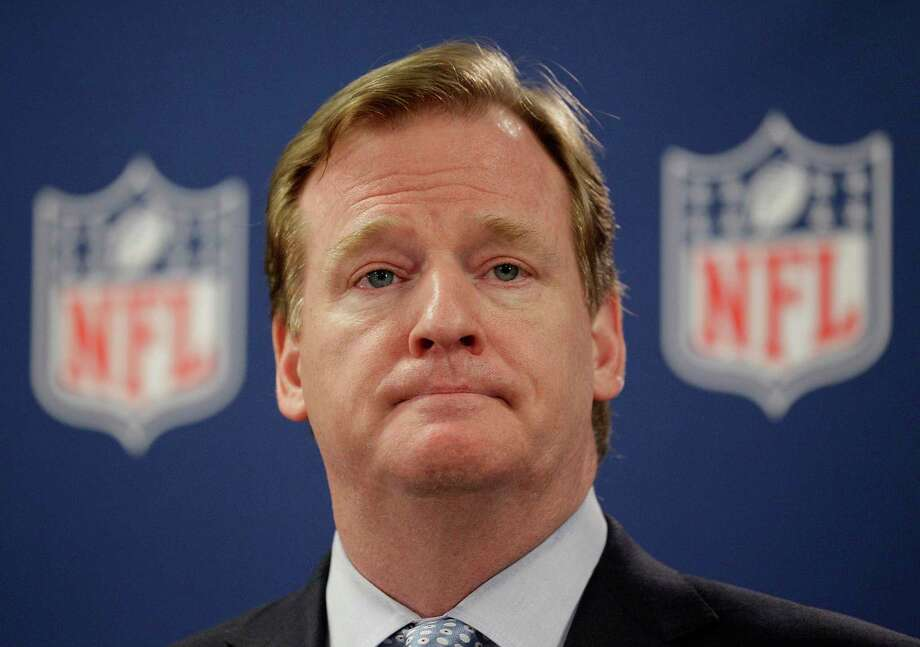 """The Ray Rice scandal has exposed NFL commissioner Roger Goodell as a liar, enabler, megalomaniac and all-around buffoon, among other less-kind adjectives according to Register columnist Chip Malafronte. Chip would like to see today's NFL players take a cue from former Bears quarterback Jim McMahon, below, and wear """"Fire Goodell"""" headbands during today's games. Photo: The Associated Press File Photos  / AP"""