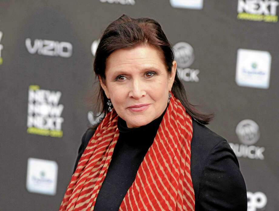 This April 7, 2011, file photo shows Carrie Fisher at the 2011 NewNowNext Awards in Los Angeles. Fisher is excited about her 'Star Wars' return, even if she canít say much about it. Production begins in May 2014 on Disney's 'Star Wars' film by director J.J. Abrams. Photo: (Chris Pizzello — The Associated Press) / AP