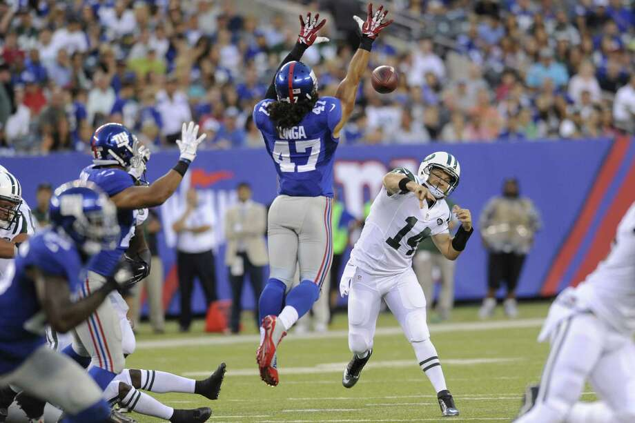 Giants linebacker Uani Unga (47) tries to defend a pass during a preseason game earlier this year. Photo: The Associated Press File Photo  / FR51951 AP