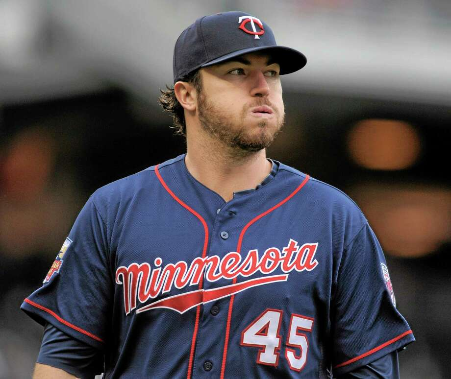 Twins starter Phil Hughes threw six innings of one-run ball and Minnesota beat the Boston Red Sox 4-3 in 10 innings on Thursday afternoon in Minneapolis. Photo: Tom Olmscheid — The Associated Press  / FR22905 AP