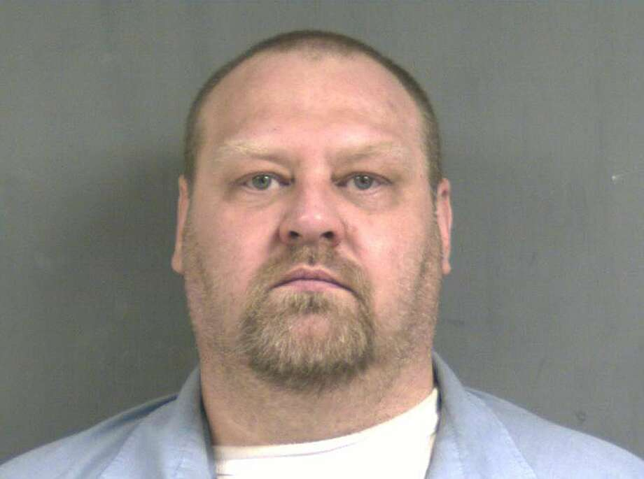 This undated booking photo provided by the Connecticut Department of Correction on Tuesday, May 12, 2015 shows inmate William Devin Howell. On Tuesday, a government official said Howell, 45, who has been behind bars for a decade for killing a woman is suspected in the slayings of seven people whose bodies were found buried in the woods behind a Connecticut shopping center. (Connecticut Department of Correction via AP) Photo: AP / Connecticut Department of Correction