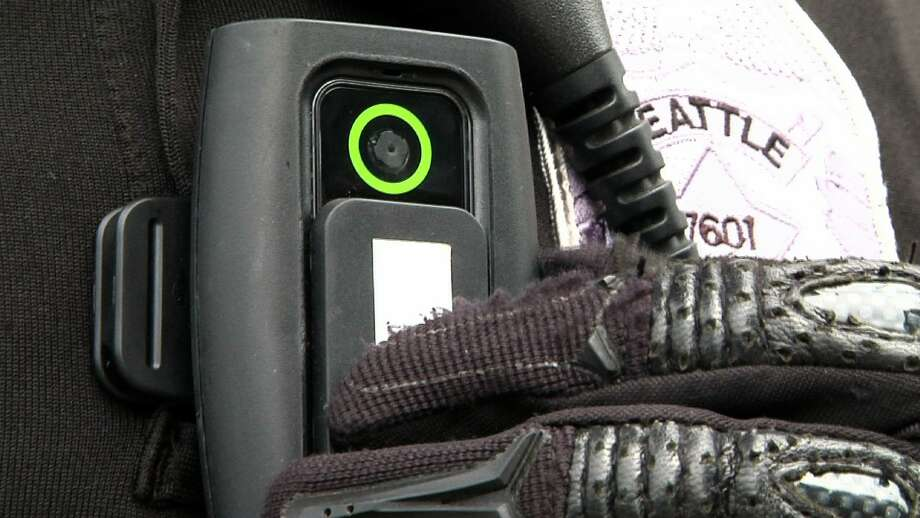 In this image from video, a body camera worn by Seattle police officer Chris Myers is shown on June 18, 2015, in Seattle. Under a pilot program, 12 officers wear body cameras, and blurred videos are released online. The use of police body cameras is spreading to keep officers honest about using force against citizens. But how and when the public gets to see the footage is up for debate. Photo: AP Photo/Manuel Valdes  / ap