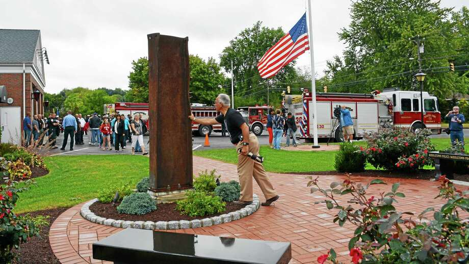 Middletown Planning and Zoning alternate and Common Council candidate Phil Pessina takes a moment to reflect on the events of Sept. 11, 2001, on Friday. Photo: Cassandra Day — The Middletown Press