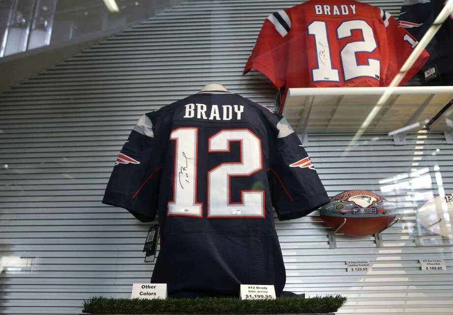 Jerseys featuring the name and number of New England Patriots quarterback Tom Brady rest in a case Wednesday at Gillette Stadium in Foxborough, Mass. Photo: Steven Senne — The Associated Press  / AP