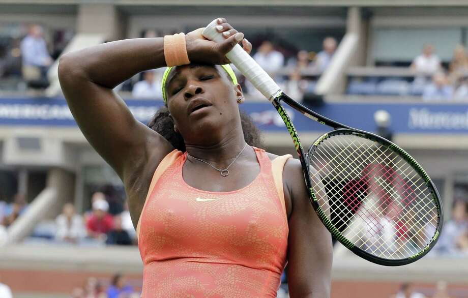 Serena Williams reacts after losing a point to Roberta Vinci during a semifinal match at the U.S. Open on Friday. Photo: Bill Kostroun — The Associated Press  / FR51951 AP