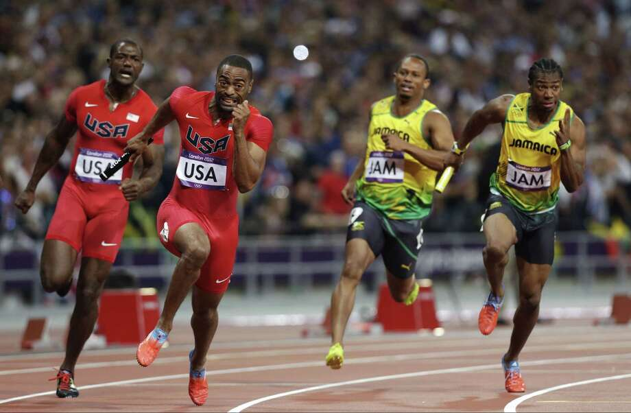 In this Aug. 11, 2012 file photo, from left, the United States' Justin Gatlin hands the baton to Tyson Gay in the men's 4x100-meter relay final during 2012 Summer Olympics in London. Photo: Hassan Ammar — The Associated Press File Photo  / AP
