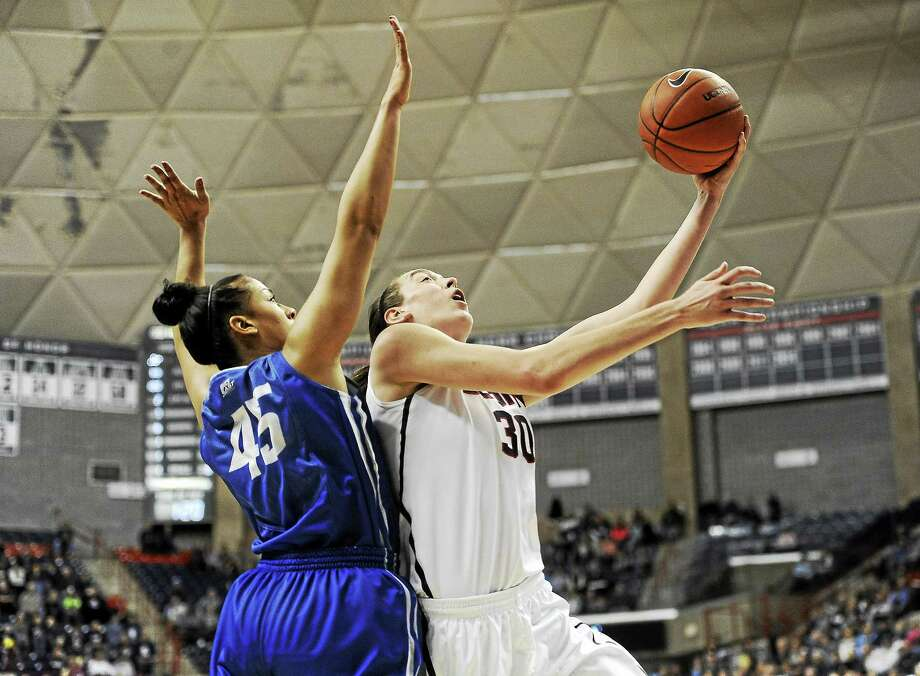 Breanna Stewart and the Huskies will be happy to be back in Gampel Pavilion. UConn's last game on campus was a 96-60 win over Alexis Akin-Otiko, left, and Creighton on Nov. 23. Photo: Jessica Hill — The Associated Press File Photo  / FR125654 AP