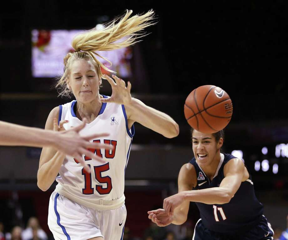 UConn guard Kia Nurse strips the ball away from SMU's Stephanie Collins during the first half of the Huskies' 87-28 win on Sunday in Dallas. Photo: Vernon Bryant — The Dallas Morning News  / The Dallas Morning News
