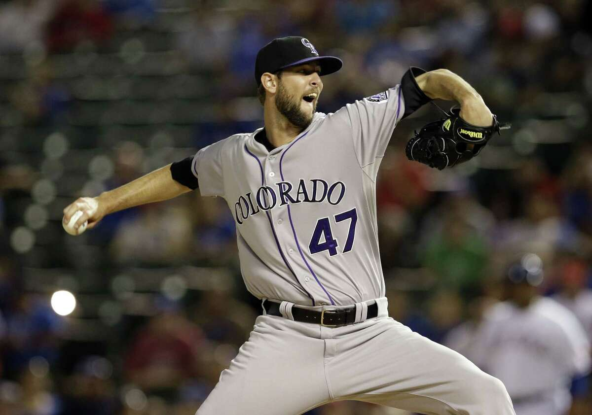 The New York Yankees acquired Colorado Rockies relief pitcher Chris Martin on Tuesday.