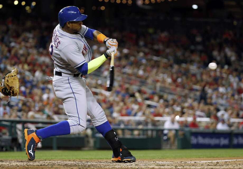 New York Mets' Yoenis Cespedes hits a two-run home run during the eighth inning against the Washington Nationals at Nationals Park Wednesday. The Mets won 5-3. Photo: Alex Brandon — The Associated Press  / AP