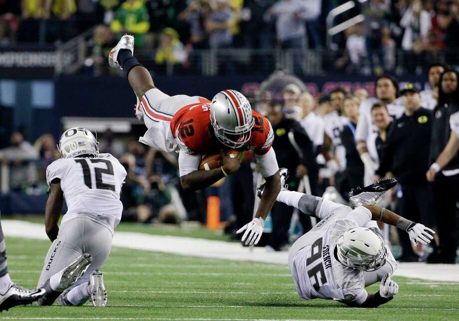 Ohio State's Cardale Jones dives for a first down during the second half of the college football national championship game against Oregon on Monday in Arlington, Texas. Photo: David J. Phillip — The Associated Press  / AP