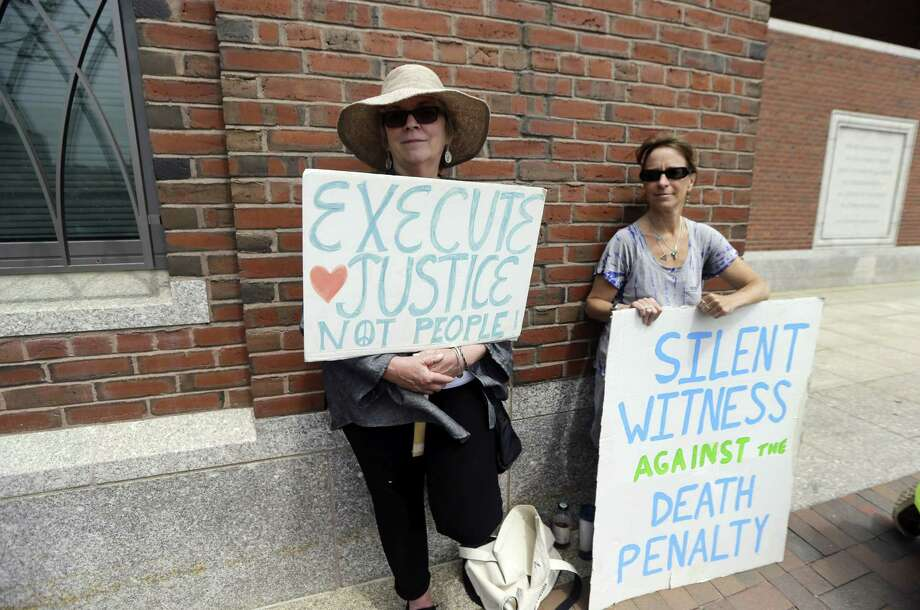 Demonstrators hold signs against the death penalty outside federal court in Boston during the penalty phase in Dzhokhar Tsarnaev's trial Monday, May 11, 2015. Tsarnaev was convicted of the Boston Marathon bombings that killed three and injured 260 people in April 2013. Photo: (AP Photo/Elise Amendola) / AP2012