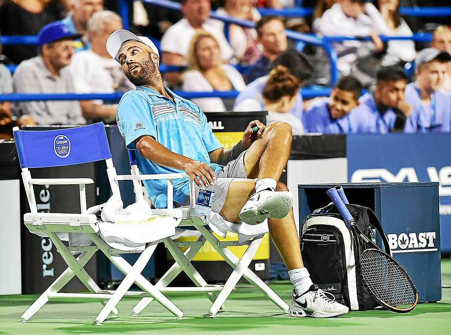 James Blake looks to the fans between sets before defeating Andy Roddick in the men's legends match on Aug. 27 at the Connecticut Open. Photo: Catherine Avalone — Register File Photo  / Catherine Avalone/New Haven Register