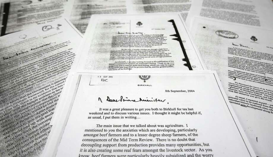 """A copy of the letter that Prince Charles The Prince of Wales wrote to the then Prime Minister Tony Blair, front centre, dated Sept. 8, 2004, one of a series of his private letters to government ministers that have been released Wednesday May 13, 2015, by the government following a lengthy legal battle.  The British government has released 27 previously secret letters written by Prince Charles to government officials, known as the """"black spider"""" memos, letters that were the subject of a lengthy legal battle by Guardian newspaper journalist Rob Evans that pitted Charles' right to privacy against the public's right to know. (Philip Toscano / PA via AP) UNITED KINGDOM OUT - NO SALES - NO ARCHIVES Photo: AP / PA"""