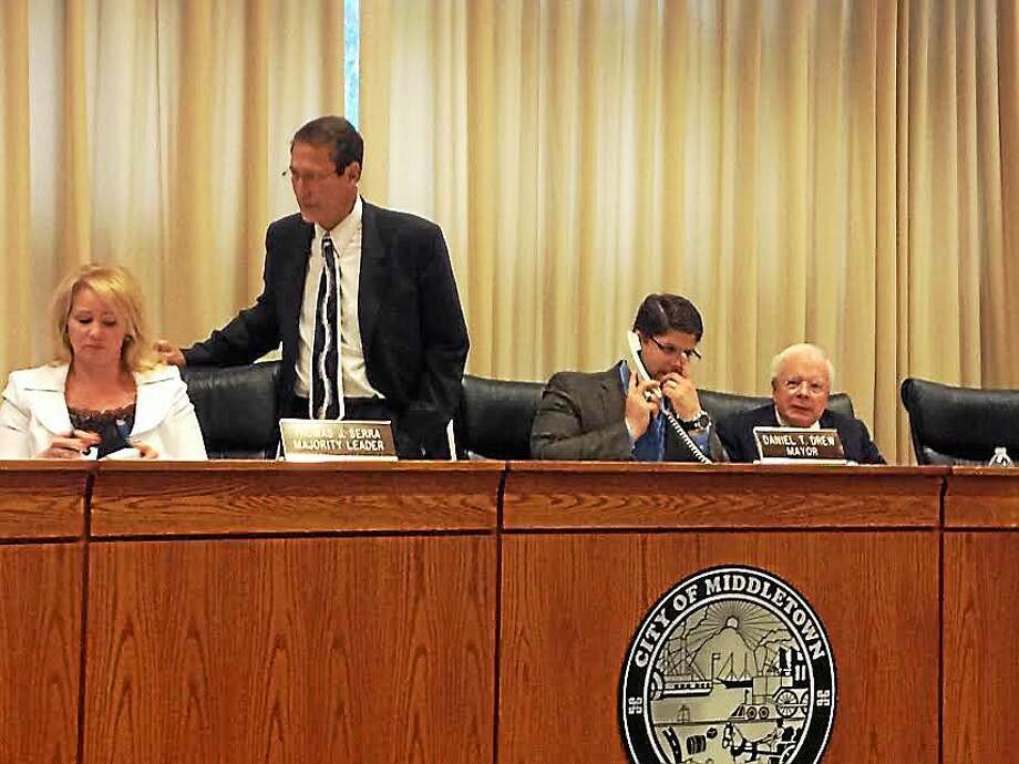 Mayor Dan Drew and members of the council gather in the council chambers prior to the unanimous approval of the 2015-16 budget. Photo: Brian Zahn — The Middletown Press