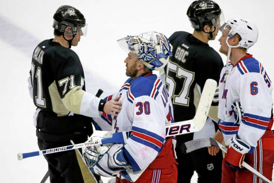 Rangers goalie Henrik Lundqvist (30) shakes hands with the Penguins' Evgeni Malkin (71) after New York's 2-1 win in Game 7 Tuesday night in Pittsburgh. Photo: The Associated Press  / AP