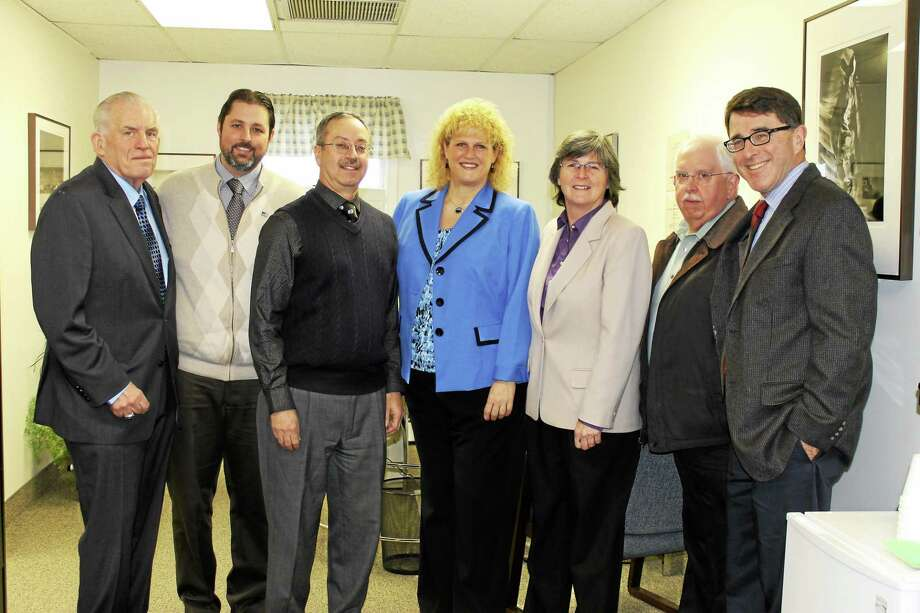 Submitted photo Chamber President Larry McHugh, Cromwell Mayor Enzo Faienza, Ray Inzero, Karen Frisk, Chamber Chairwoman Darlene Briggs, Councilman Allan Spotts and Town Planner Stuart Popper attended the AccountServe grand opening in Cromwell. Photo: Journal Register Co.