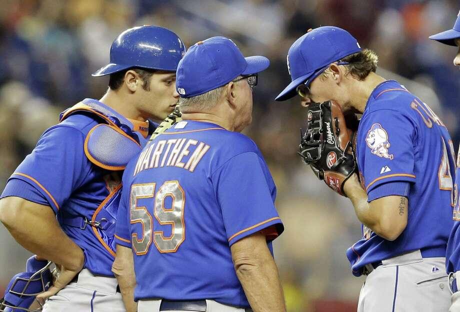 New York Mets pitching coach Dan Warthen (59) has been hospitalized in Atlanta with an irregular heartbeat. Photo: Alan Diaz — The Associated Press  / AP