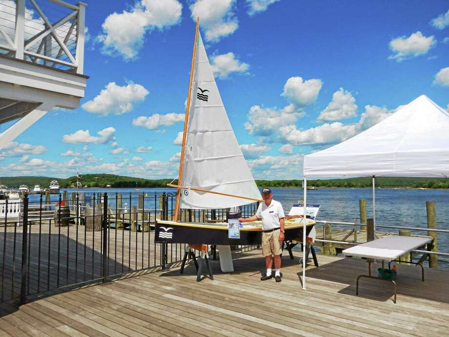 Shipbuilder Paul Kessinger is shown with a CRM 12 that has been converted to sail. Photo: Courtesy Connecticut River Museum