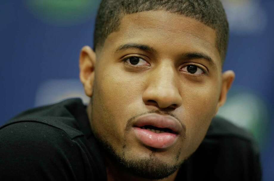 The Indiana Pacers' Paul George defended Ray Rice on Twitter on Thursday, then backtracked less than an hour later by deleting the posts and apologizing to women and victims of domestic violence. Photo: Darron Cummings — The Associated Press  / AP