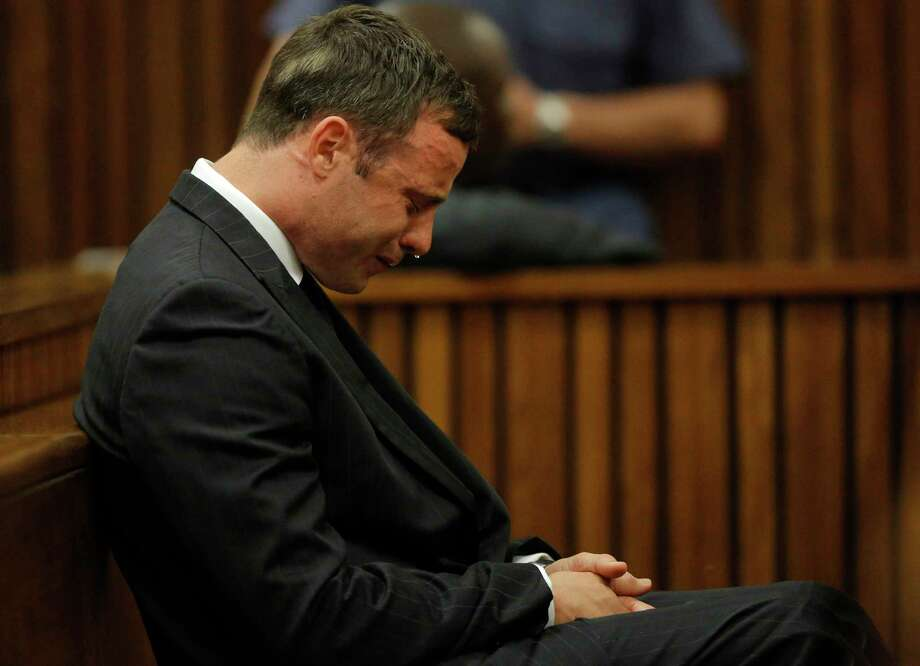 Oscar Pistorius cries in the dock Thursday in Pretoria, South Africa, as Judge Thokozile Masipa reads notes as she delivers her verdict in Pistorius' murder trial. Photo: Kim Ludbrook — The Associated Press  / Pool EPA