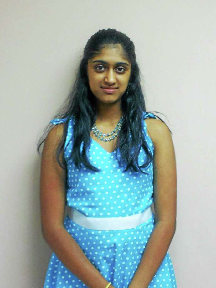 Deepika Ravichandran, 15, of East Hampton has won the Guinness World Record to become the fastest puzzler. Photo: Courtesy Photo