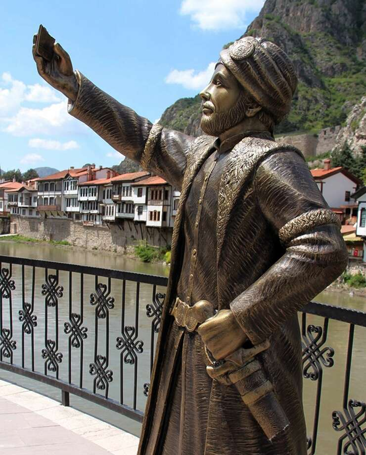 This May 10, 2015 photo shows a statue of an Ottoman prince taking a selfie with a cellphone erected in Amasya, Turkey. The statue has met swift and violent criticism and just days after it was erected, vandals _ perhaps offended by disparagement of Ottoman history _ have hacked off the phone and the princeís sword. The mayorís office in Amasya, an hour south of the Black Sea coast, says police have been ordered to guard the disarmed prince. Photo: (AP Photo) TURKEY OUT - ONLINE OUT / AP