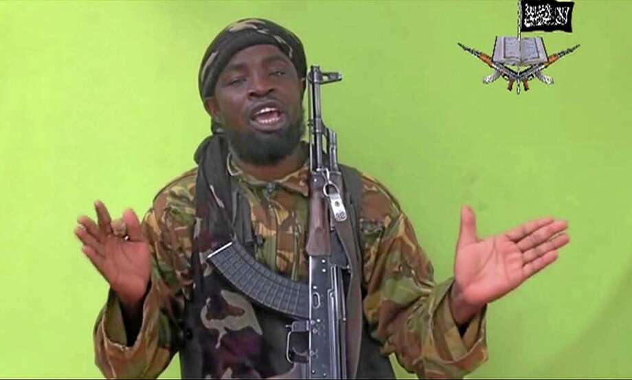 In this  photo taken from video by Nigeria's Boko Haram terrorist network, Monday May 12, 2014 shows their  leader Abubakar Shekau speaking to the camera. The new video purports to show dozens of abducted schoolgirls, covered in jihab and praying in Arabic. It is the first public sight of the girls since more than 300 were kidnapped from a northeastern school the night of April 14  exactly four weeks ago. (AP Photo) Photo: AP  / Militant Video