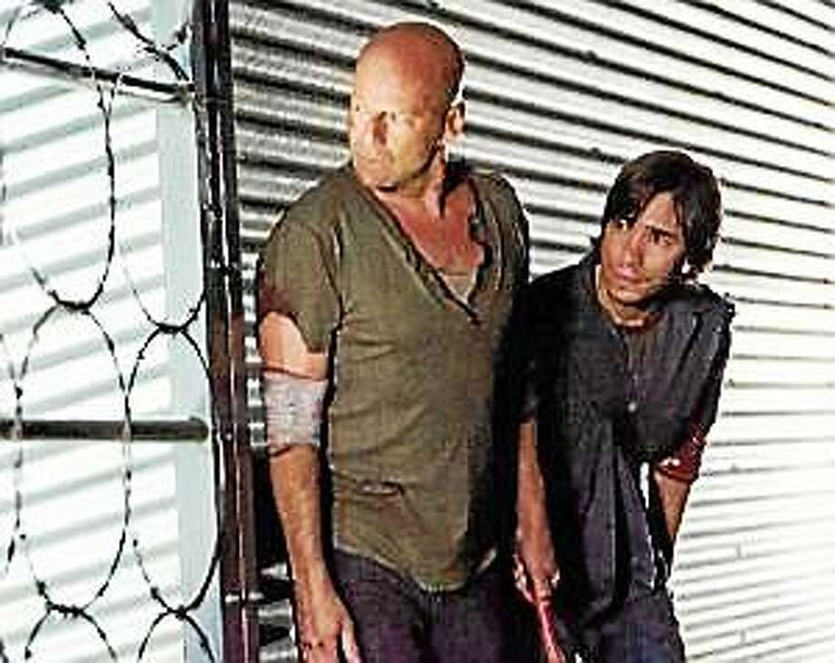 "John McClane (Bruce Willis), left, and Matt Farrell (Justin Long) in ""Live Free or Die Hard."" Photo: (MCT)"