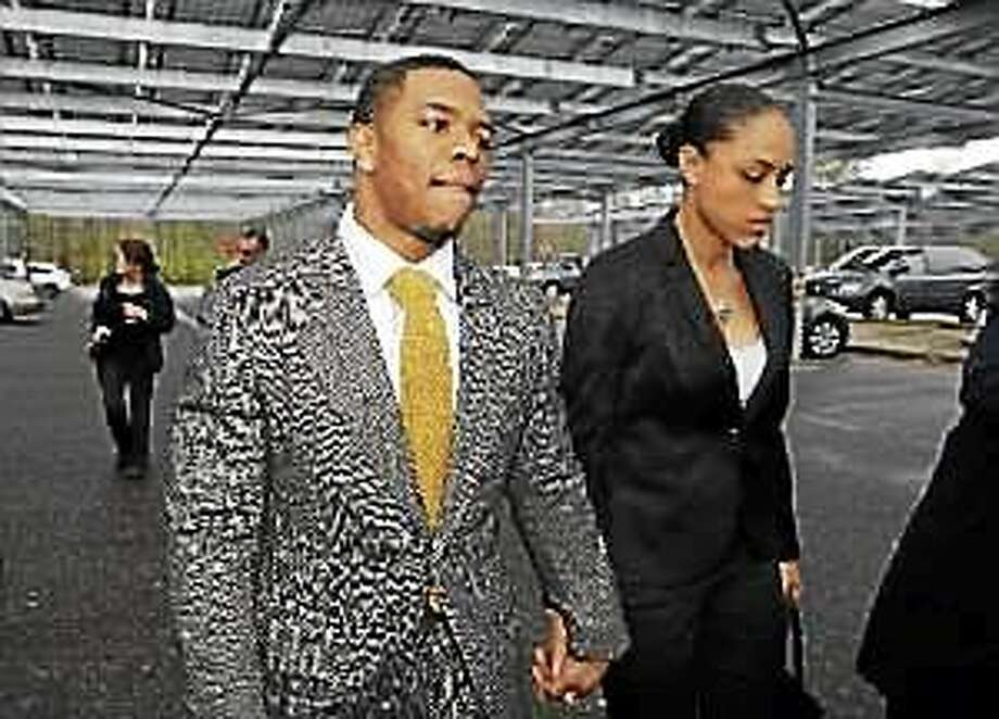 In this May 1, 2014, file photo, former Baltimore Ravens football player Ray Rice holds hands with his wife, Janay Palmer, as they arrive at Atlantic County Criminal Courthouse in Mays Landing, N.J. Photo: (Mel Evans — The Associated Press)