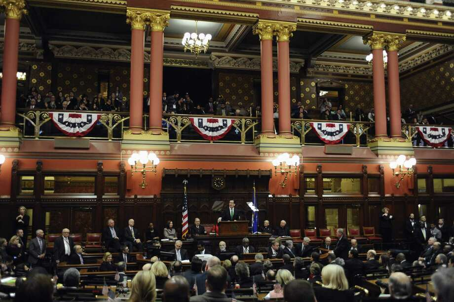 Gov. Dannel P. Malloy delivers the 2015 State of the State address in front of a joint session of the legislature in the House Chambers at the Capitol Wednesday in Hartford. Photo: Associated Press  / FR125654 AP