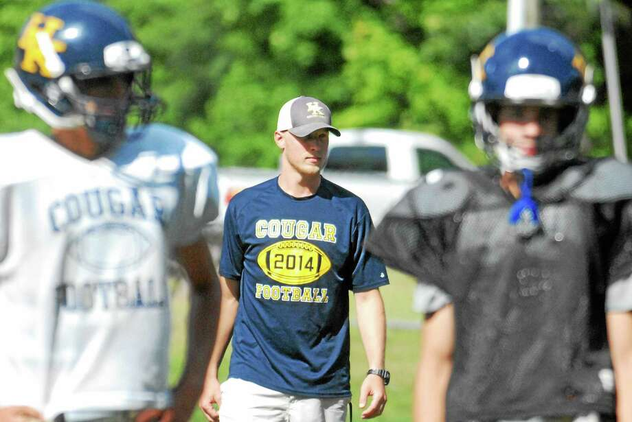 Haddam-Killingworth first-year head coach Mike Baklik gets the Cougars ready for Friday's opener against Morgan. Photo: Jimmy Zanor — Middletown Press