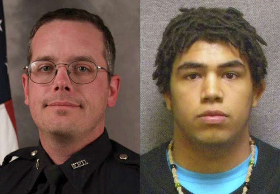 This combination made with file photos provided by the Madison, Wis. police department and Wisconsin Department of Corrections shows Madison Police officer Matt Kenny, left, and Tony Robinson, a biracial man who was killed by the officer. Kenny shot the unarmed 19-year-old in an apartment house on March 6. Photo: (Madison Police Department/Wisconsin Department Of Corrections Via AP) / Madison Police Department