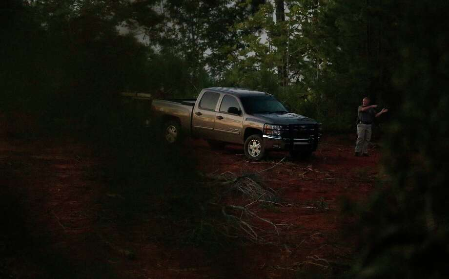 An investigator leads a truck near the crime scene on Tuesday, Sept. 9, 2014, in Camden, Ala. Wilcox County, Alabama, District Attorney Michael Jackson told The Associated Press that Timothy Ray Jones Jr. is suspected of killing his children in South Carolina and leaving their bodies in a rural area near Camden. (AP Photo/Brynn Anderson) Photo: AP / AP